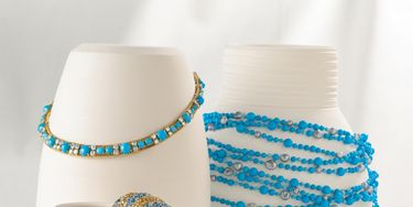 """<p><h2>Clockwise From Top Left:</h2><p>  Turquoise and diamond Tradition necklace in yellow gold from <a href=""""http://www.cartier.com/"""" target=""""_blank""""> Cartier</a>, Paris, 1952. <a href=""""http://www.mishnewyork.com/"""" target=""""_blank"""">Mish New York's</a> multistrand turquoise necklace with multiple keshi and freshwater pearls and 18k yellow gold Bamboo hook-and-eye clasp. Jean Schlumberger's turquoise Tassel ear clips with diamonds in 18k yellow gold from <a href=""""http://www.tiffany.com/Shopping/Category.aspx?cid=288190&mcat=148206/"""" target=""""_blank"""">Tiffany & Co.</a> Triple-strand drop turquoise earrings with diamonds in sterling silver from <a href=""""http://www.slaneandslane.com/"""" target=""""_blank"""">Slane & Slane</a>. Estate bracelet in platinum set with turquoise and diamonds from <a href=""""http://www.vancleef-arpels.com/"""" target=""""_blank"""">Van Cleef & Arpels</a>. <a href=""""http://www.johnhardy.com/"""" target=""""_blank"""">John Hardy's</a> one-of-a-kind cabochon turquoise kick-cuff with white and cognac diamonds and blue topaz set in 18k yellow gold."""
