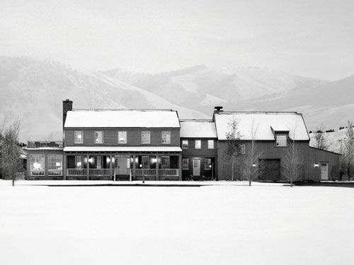 A Jackson Hole home with farmhouse finesse wears a mantle of snow after a storm lingering at higher altitudes.