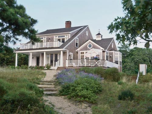 On the site of her family's longtime beach cottage on Cape Cod, Meredith Hutchison designed a larger structure with the same spirit. Two upstairs master bedrooms face bay. <i>Far right</i>, outdoor shower.