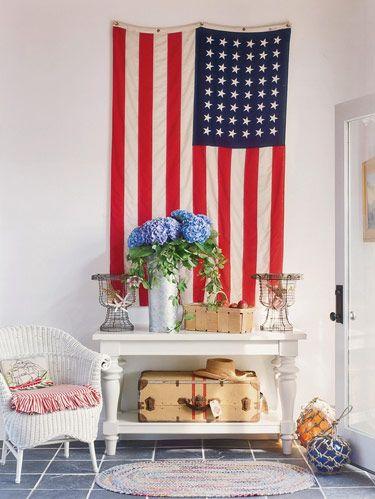 In entry, wicker chair, schooner pillow, buoy balls, wire urns and suitcase, all antiques. Emtek door hardware.