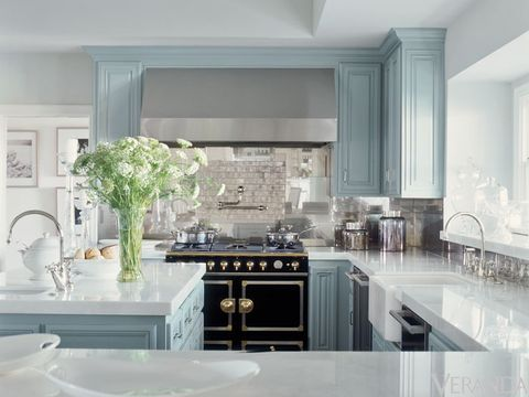 """There are all these tones of gray, and we played with that—using a bit more of a gray-taupe here, a bit more of a gray-blue there,"" says interior designer Michelle Workman. ""It's almost like a black-and-white film from the forties."""