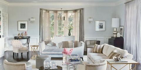"""Custom klismos chairs in <a href=""""http://www.calvinklein.com/category/index.jsp?categoryId=3134336/"""" target=""""_blank"""">Calvin Klein Home</a> fabric for <a href=""""http://www.kravet.com/"""" target=""""_blank"""">Kravet</a>. Tête-à-tête sofa, <a href=""""http://www.michaelbermanlimited.com/"""" target=""""_blank"""">Michael Berman Limited</a>, in Casamance fabric. Side tables, Global Views. Charles Hollis Jones coffee table. Custom sofa in <a href=""""http://www.manuelcanovas.com/en//"""" target=""""_blank"""">Manuel Canovas</a> fabric. Pillows in <a href=""""http://www.scalamandre.com/"""" target=""""_blank"""">Scalamandré</a> stripe. Tufted chair, <a href=""""http://hollyhockinc.com/"""" target=""""_blank"""">Hollyhock</a>. Fretwork chair, <a href=""""http://www.mcguirefurniture.com/"""" target=""""_blank"""">McGuire</a>. Curtains in <a href=""""http://www.fschumacher.com/"""" target=""""_blank"""">Schumacher</a> silk."""
