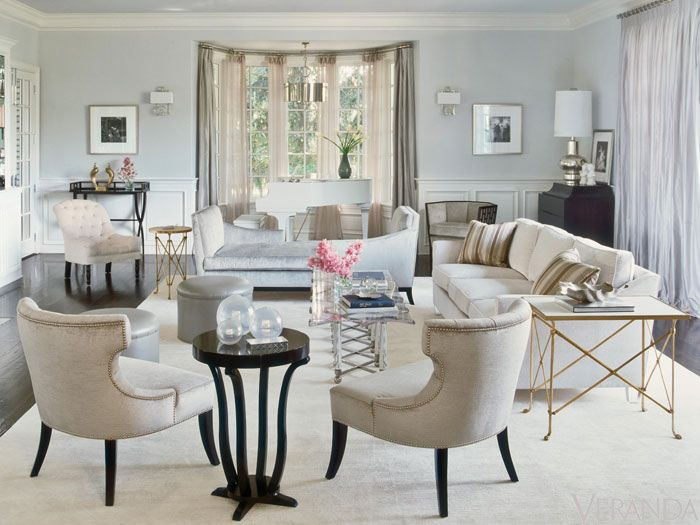 "Custom klismos chairs in <a href=""http://www.calvinklein.com/category/index.jsp?categoryId=3134336/"" target=""_blank"">Calvin Klein Home</a> fabric for <a href=""http://www.kravet.com/"" target=""_blank"">Kravet</a>. Tête-à-tête sofa, <a href=""http://www.michaelbermanlimited.com/"" target=""_blank"">Michael Berman Limited</a>, in Casamance fabric. Side tables, Global Views. Charles Hollis Jones coffee table. Custom sofa in <a href=""http://www.manuelcanovas.com/en//"" target=""_blank"">Manuel Canovas</a> fabric. Pillows in <a href=""http://www.scalamandre.com/"" target=""_blank"">Scalamandré</a> stripe. Tufted chair, <a href=""http://hollyhockinc.com/"" target=""_blank"">Hollyhock</a>. Fretwork chair, <a href=""http://www.mcguirefurniture.com/"" target=""_blank"">McGuire</a>. Curtains in <a href=""http://www.fschumacher.com/"" target=""_blank"">Schumacher</a> silk."