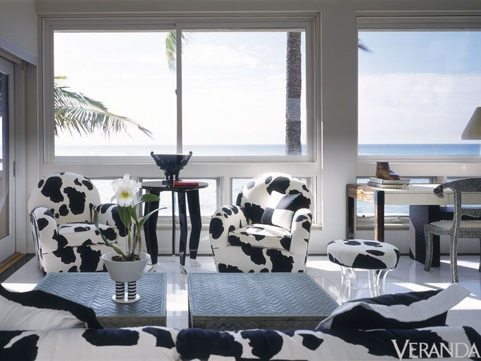 The Holstein cow printed chairs, ottoman and sofa show Beene's playful attitude towards design.