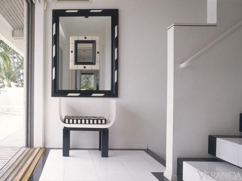 Accents of black and white echo throughout the house, from the mirrors to the detail of the black marble piping on the stairs.