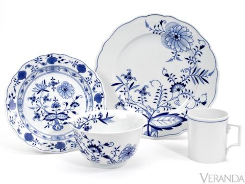 "As the quintessential blue-and-white pattern, Blue Onion is Meissen's best-known and most collectible porcelain. Contrary to its name, these so-called ""onions"" have no relation to the common onion and instead represent symbols of Asian cultures: pomegranates, peaches, bamboo, lotus flowers, and chrysanthemums. Blue Onion from Meissen, from $500 for 5-piece place setting."