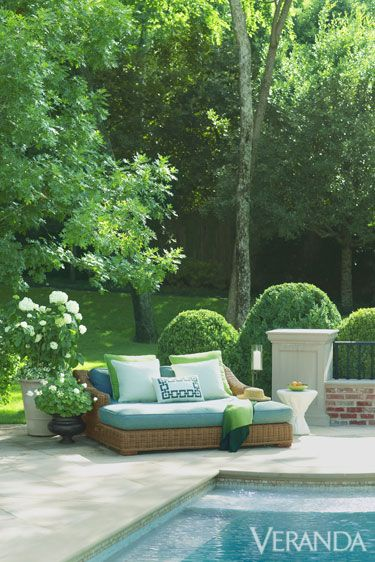 Green, Plant, Shrub, Garden, Flowerpot, Swimming pool, Turquoise, Pillow, Outdoor sofa, Outdoor furniture,