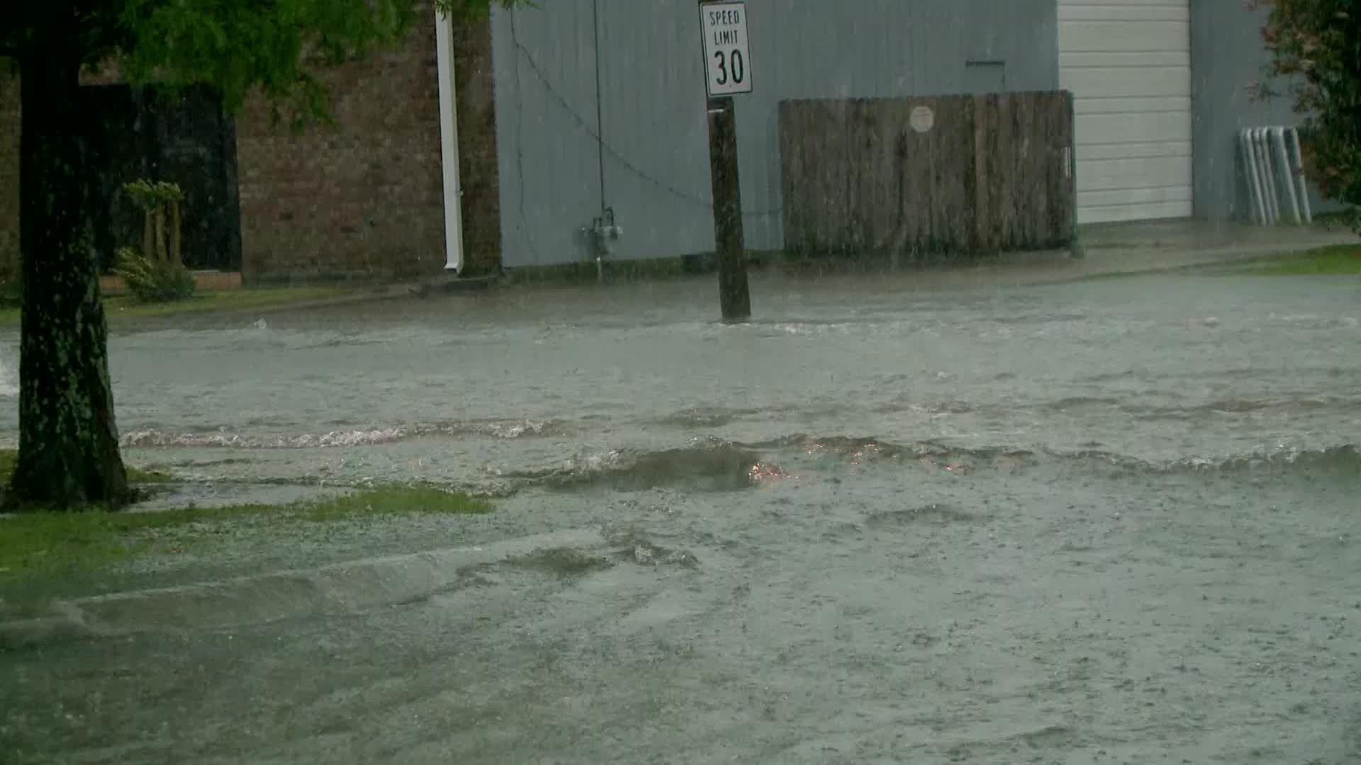 High water covers Third Street in Kenner