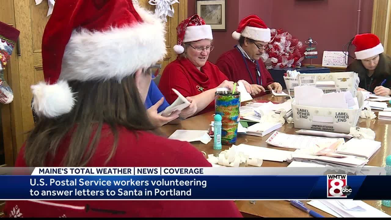 postal workers help santa answer letters