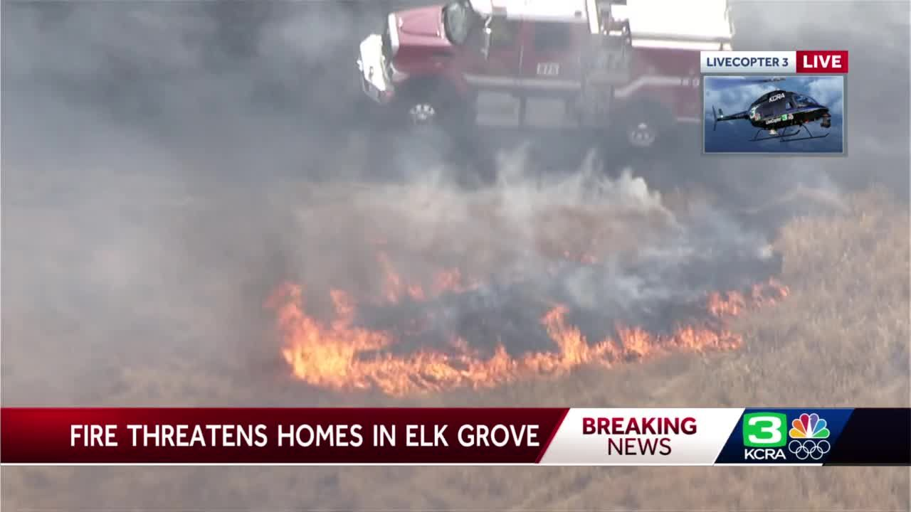 Structures threatened as crews battle grass fire in Sacramento County