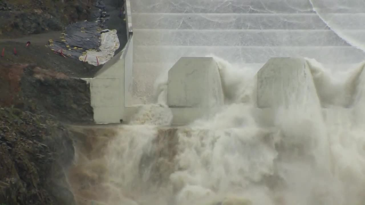 Water spills down rebuilt Oroville Dam Spillway for first time