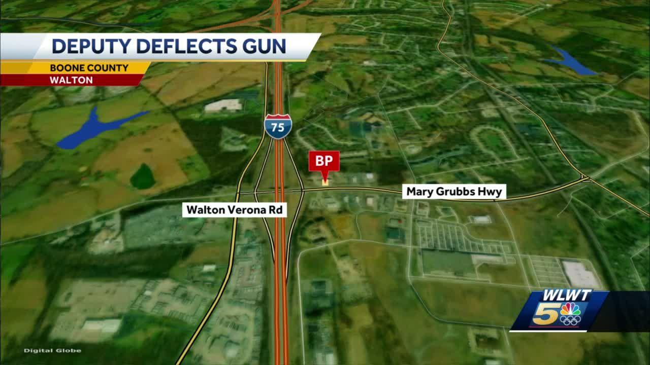 Deputy deflects gun