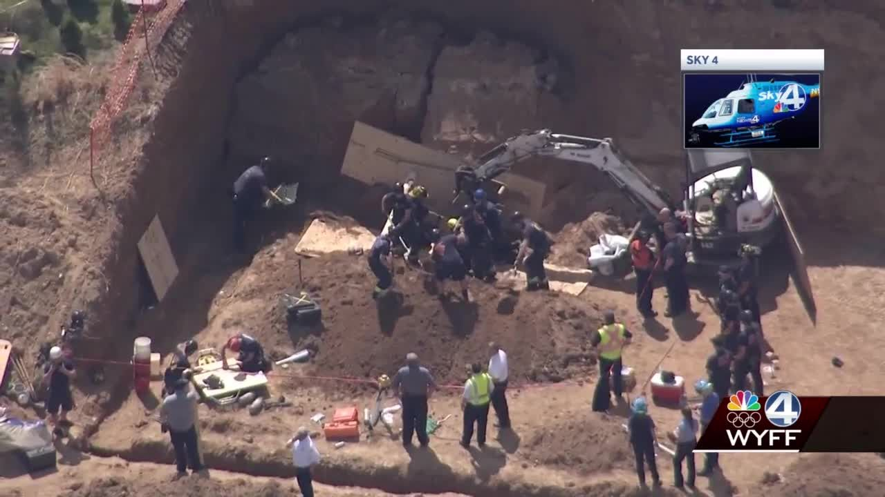 Trench rescue successful in Asheville after one person trapped in wall of dirt, officials say