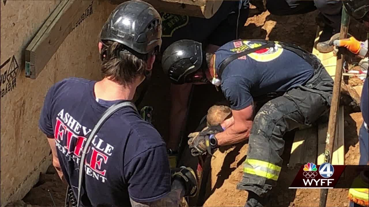 Trench rescue underway in Asheville after one person trapped, officials say
