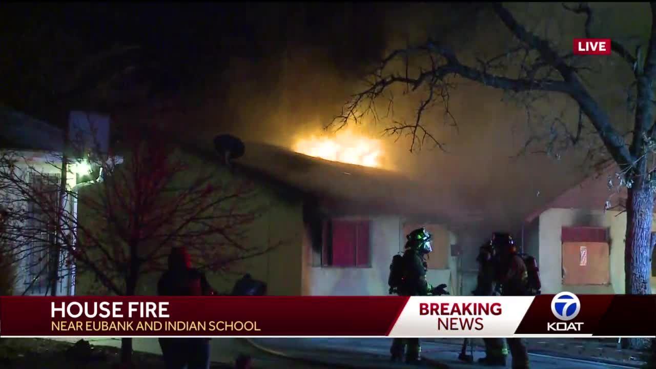 Crews battle AM house fire