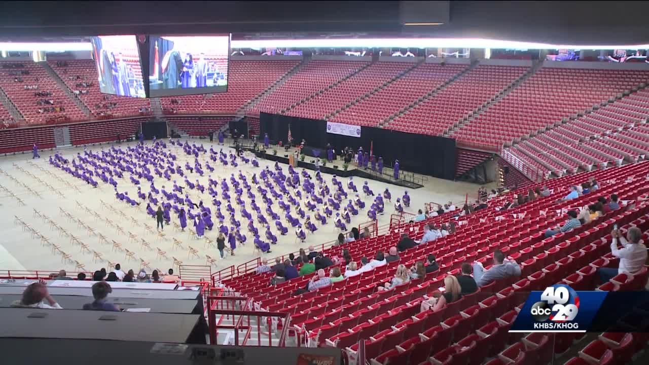 Fayetteville High School students graduate in person at Bud Walton Arena