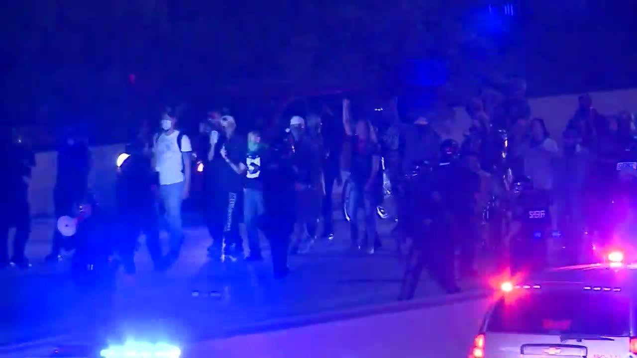 Breonna Taylor protesters walk down I-94