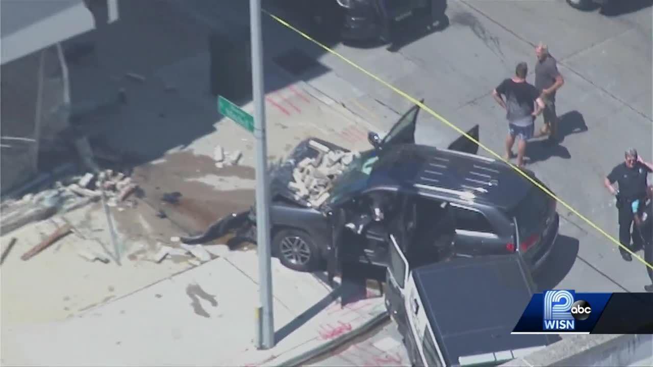 Stolen car slams into building