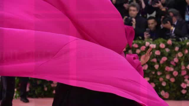 Lady Gaga performed a strip tease on the Met Gala red carpet