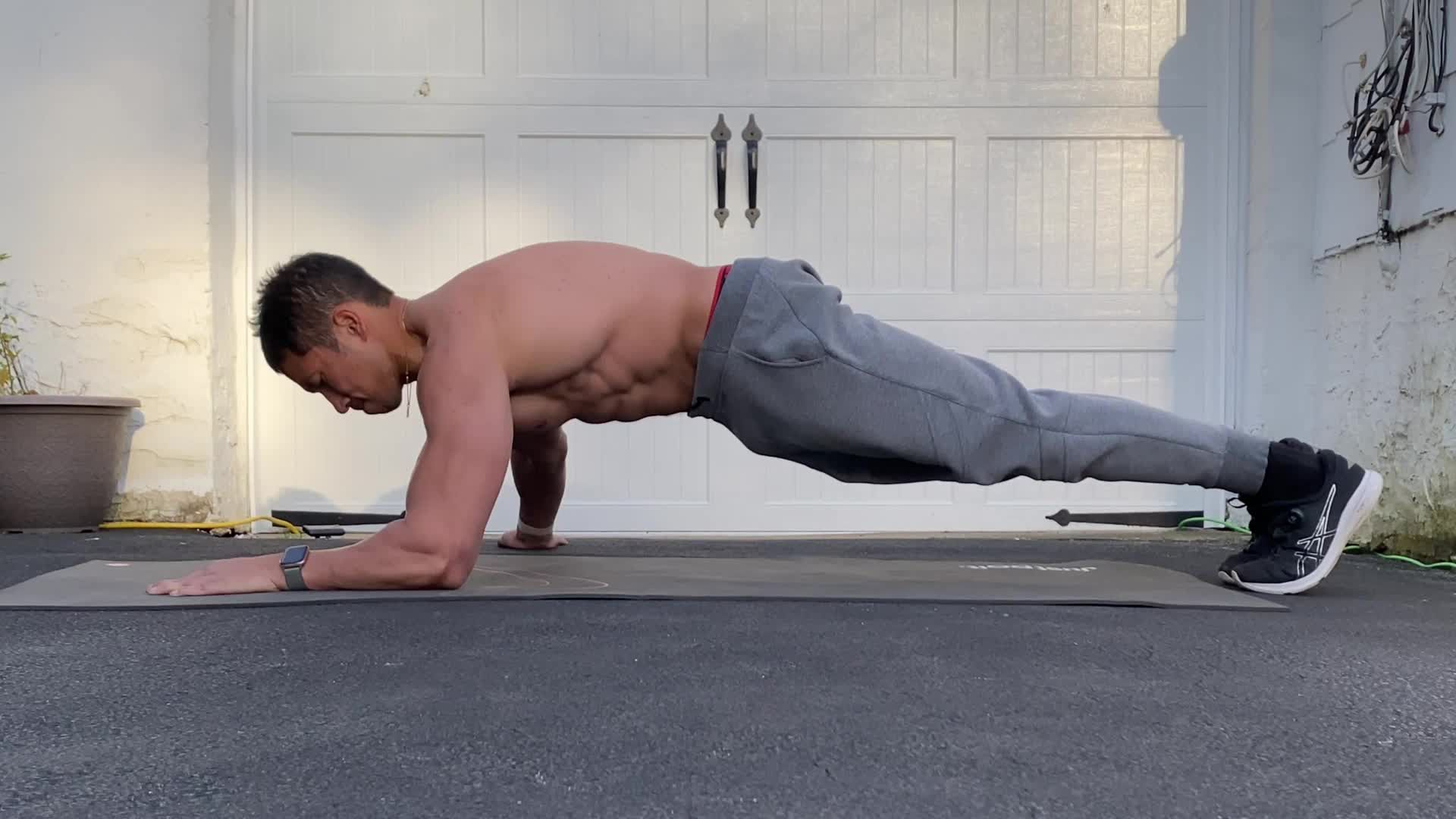 Blast Your Arms and Abs At Once with the Archer-Position Bodyweight Skullcrusher