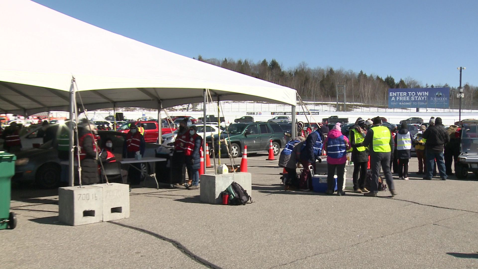 Some wait hours as thousands receive vaccinations at New England race track