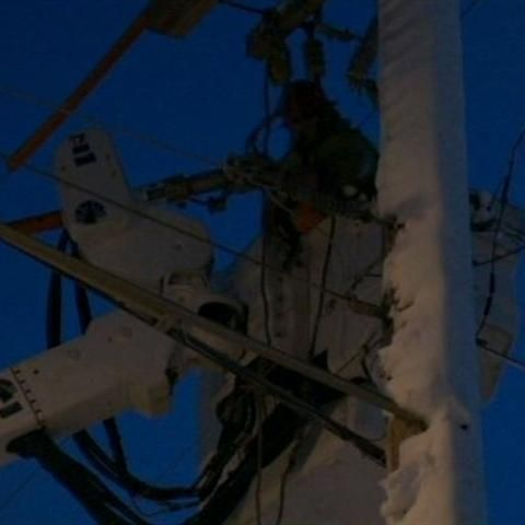 We Energies crews working restore power outages