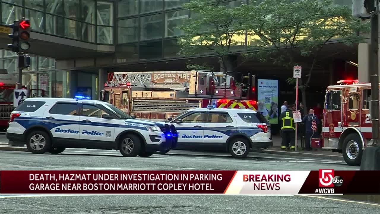 Police investigating after person found dead in parking garage
