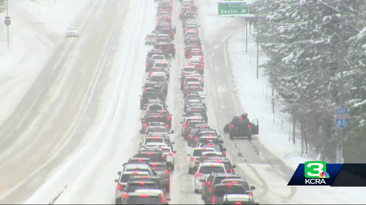 Snowy conditions back up traffic on I-80 in Sierra