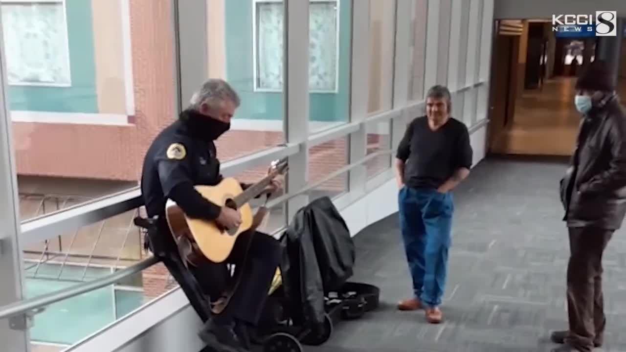 WATCH: Iowa officer captured singing in skywalk