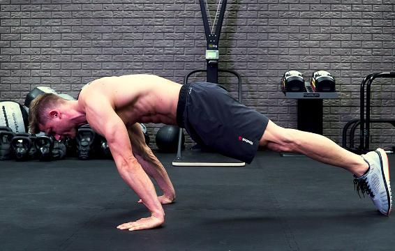 The Planche Rock to Pushup Will Carve Up Some Superhuman Abs