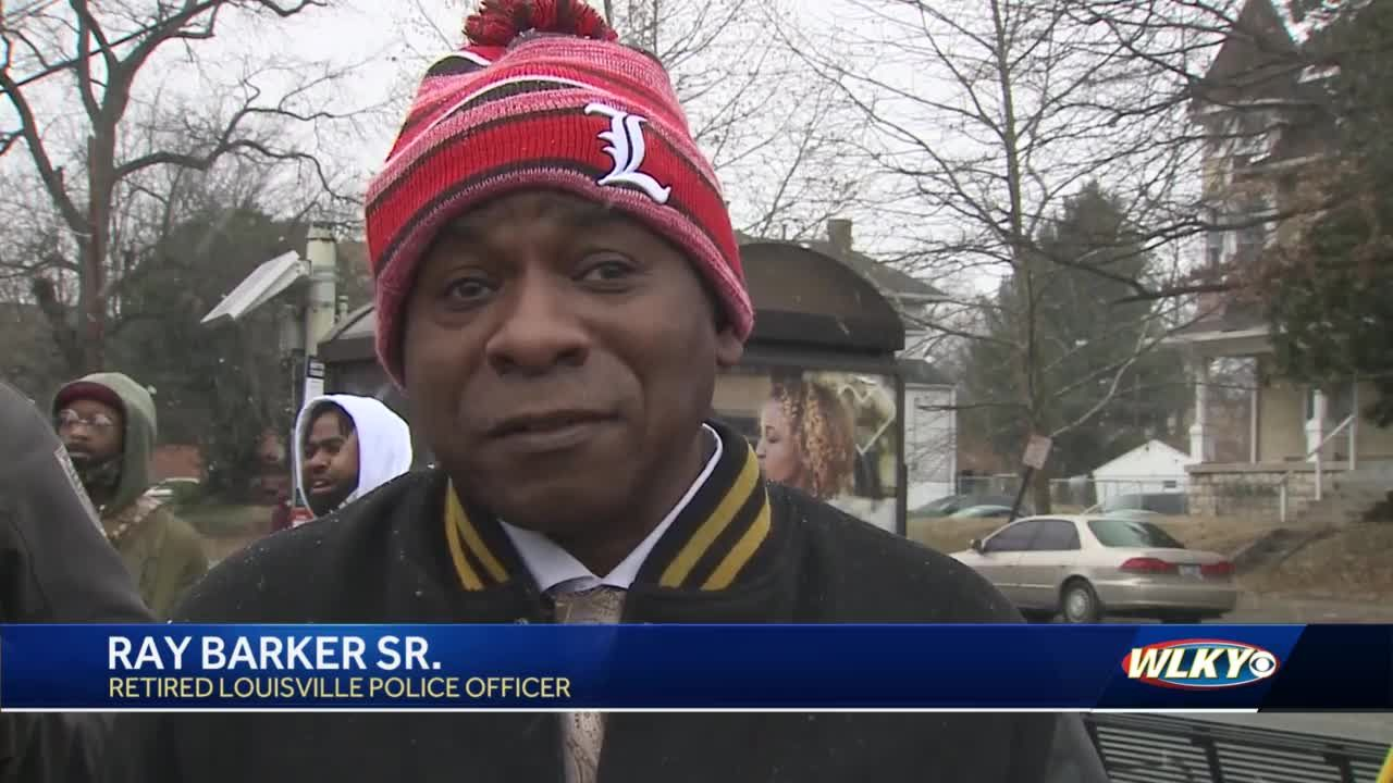 """Honorary street sign revealed in West Louisville for retired police officer """"Sir Friendly C"""""""