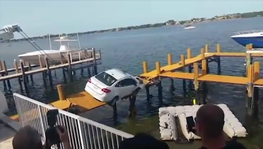 Car Dangles On Boat Dock In Florida