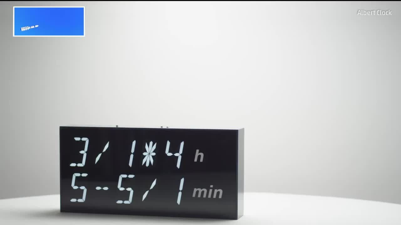Digital clock uses math problems to tell time