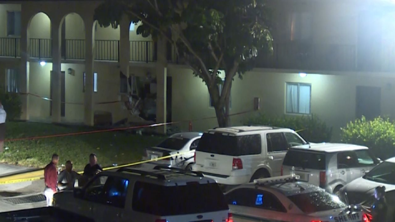 Two dead after car crashes into apartment