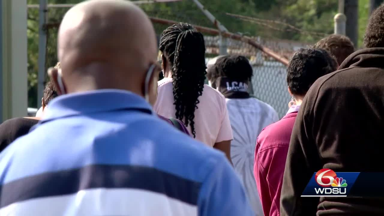 long lines reported throughout city on first day of early voting