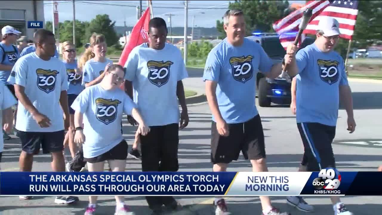 Police officers will carry the Arkansas Special Olympics torch today