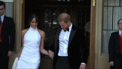 meghan markle heads to reception in second royal wedding dress by stella mccartney reception in second royal wedding dress