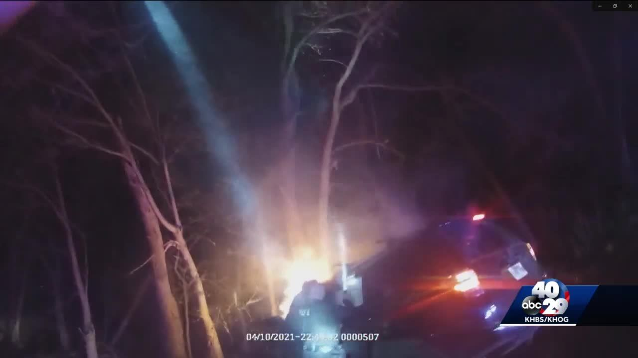 Tontitown police officers save woman from burning car after a police pursuit