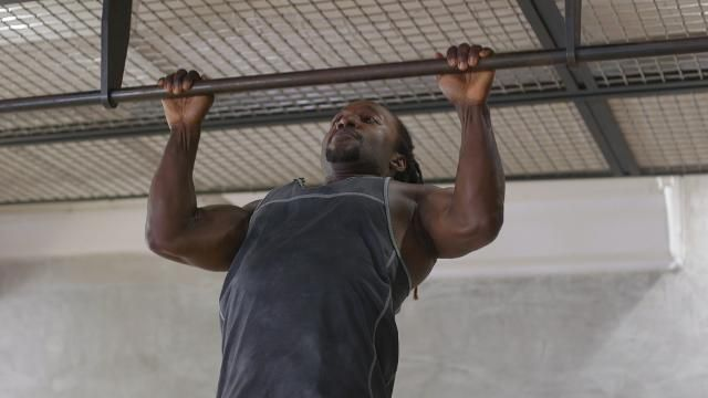 Here's How to Work Your Way to a Pullup From the Ground Up