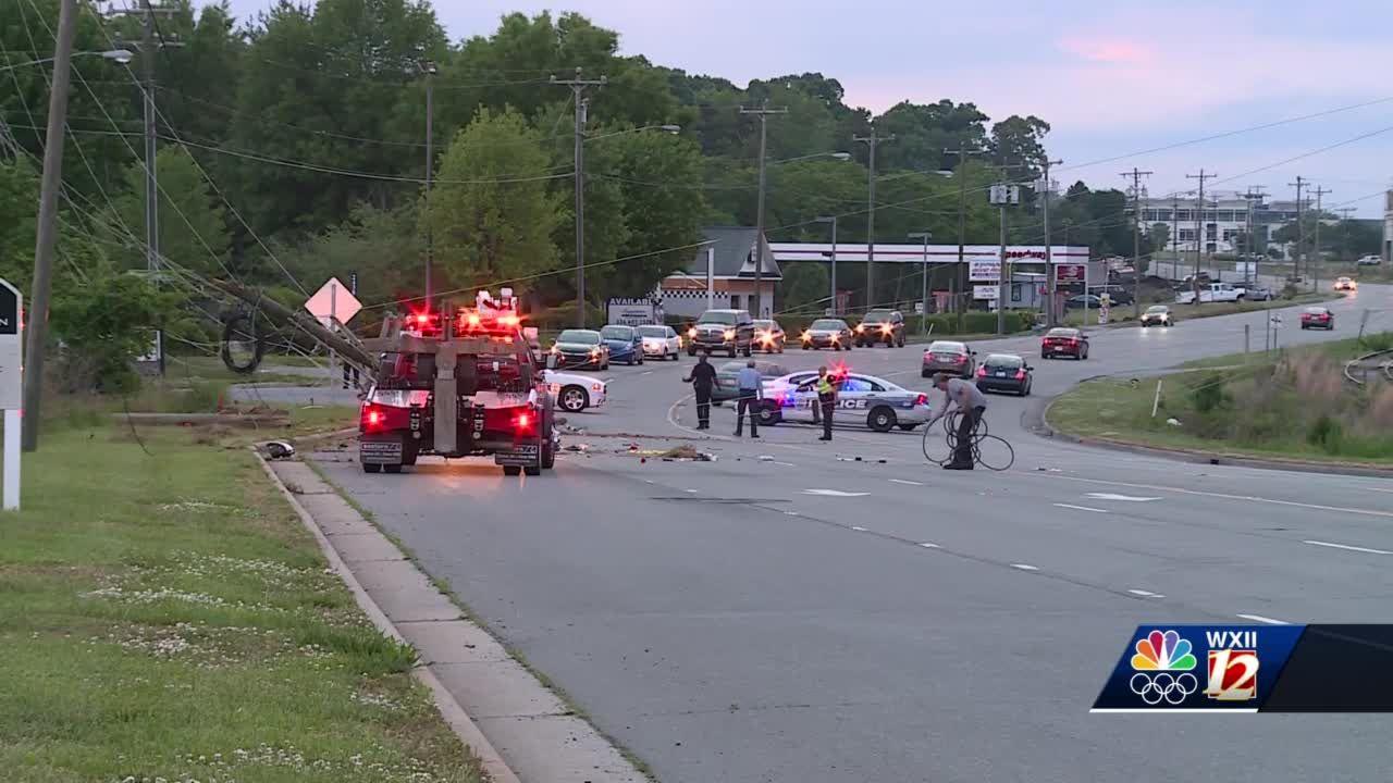 Winston-Salem crash knocks down power poles, backs up traffic