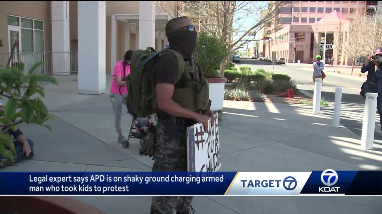 Legal expert says APD is on shaky ground charging armed man who took kids to protest