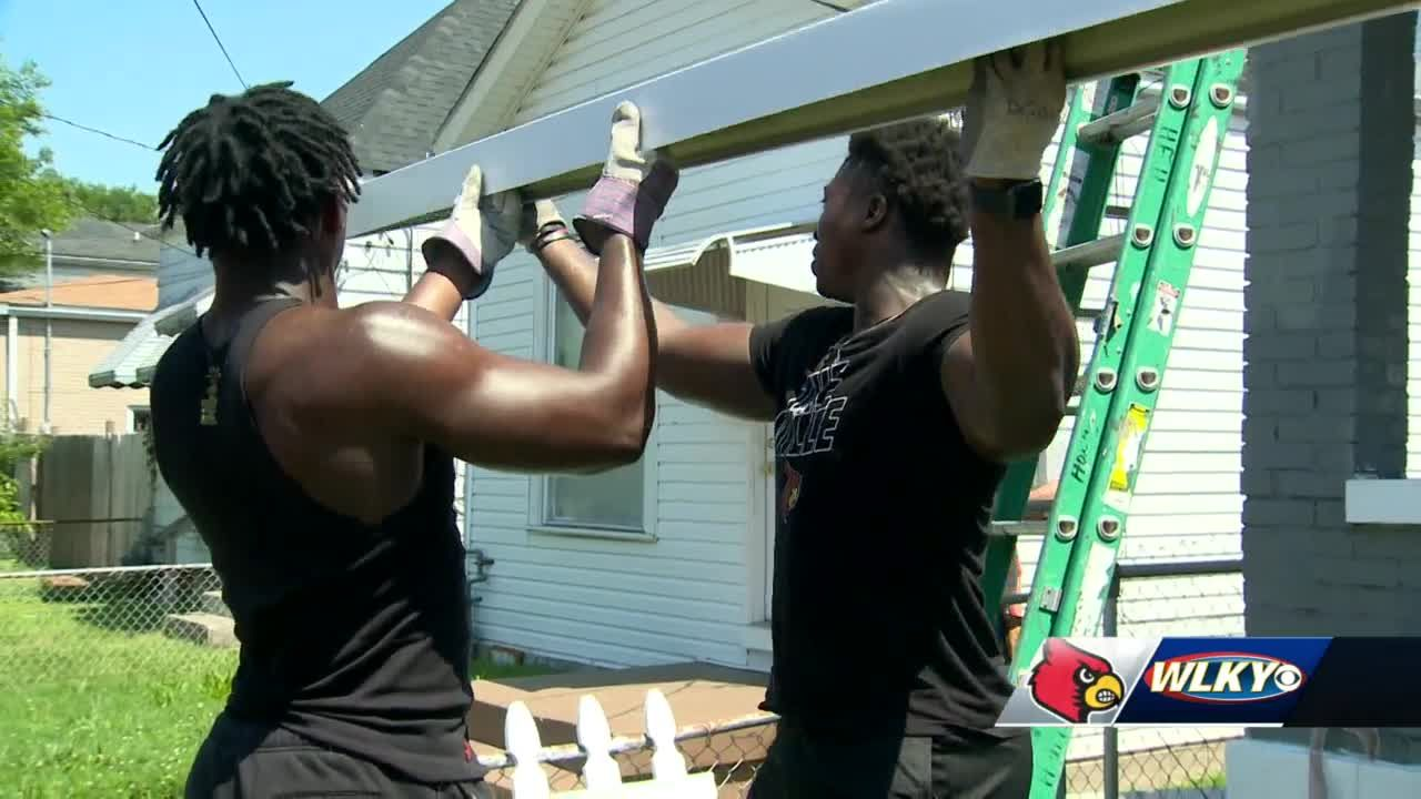 UofL football players spend time repairing, cleaning up home in Portland neighborhood