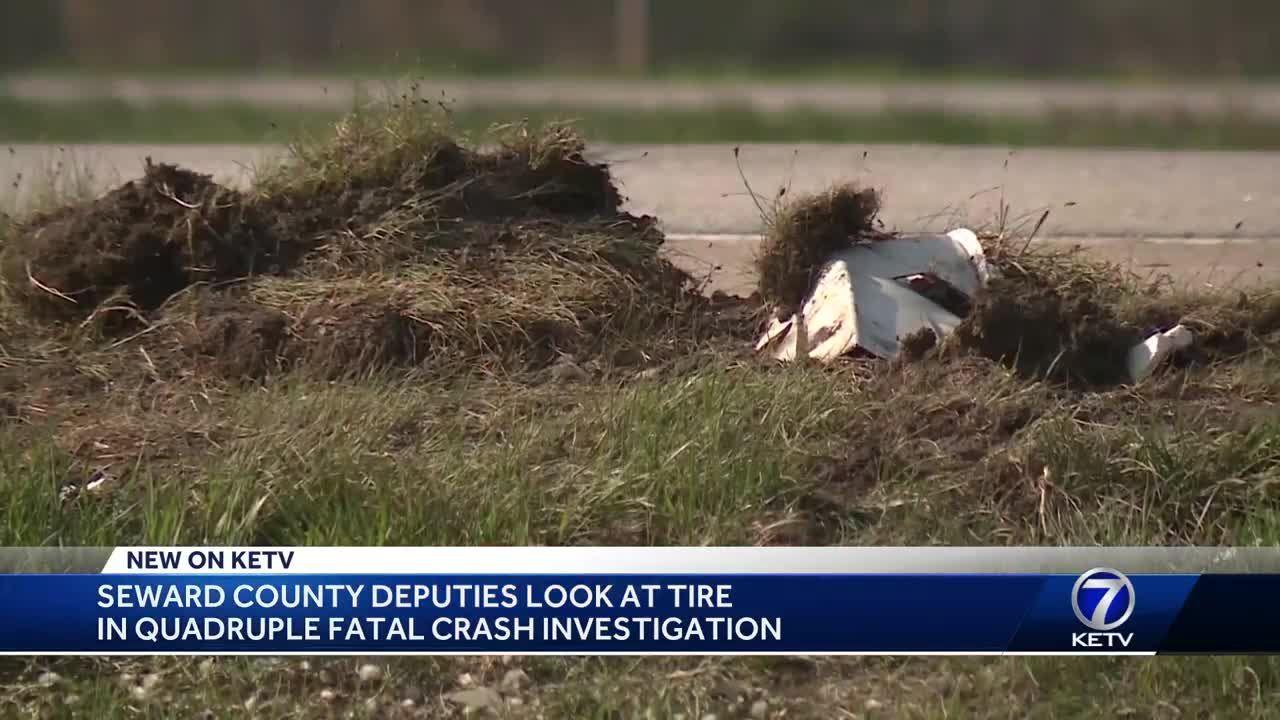 Seward County deputies look at tire in quadruple fatal crash investigation