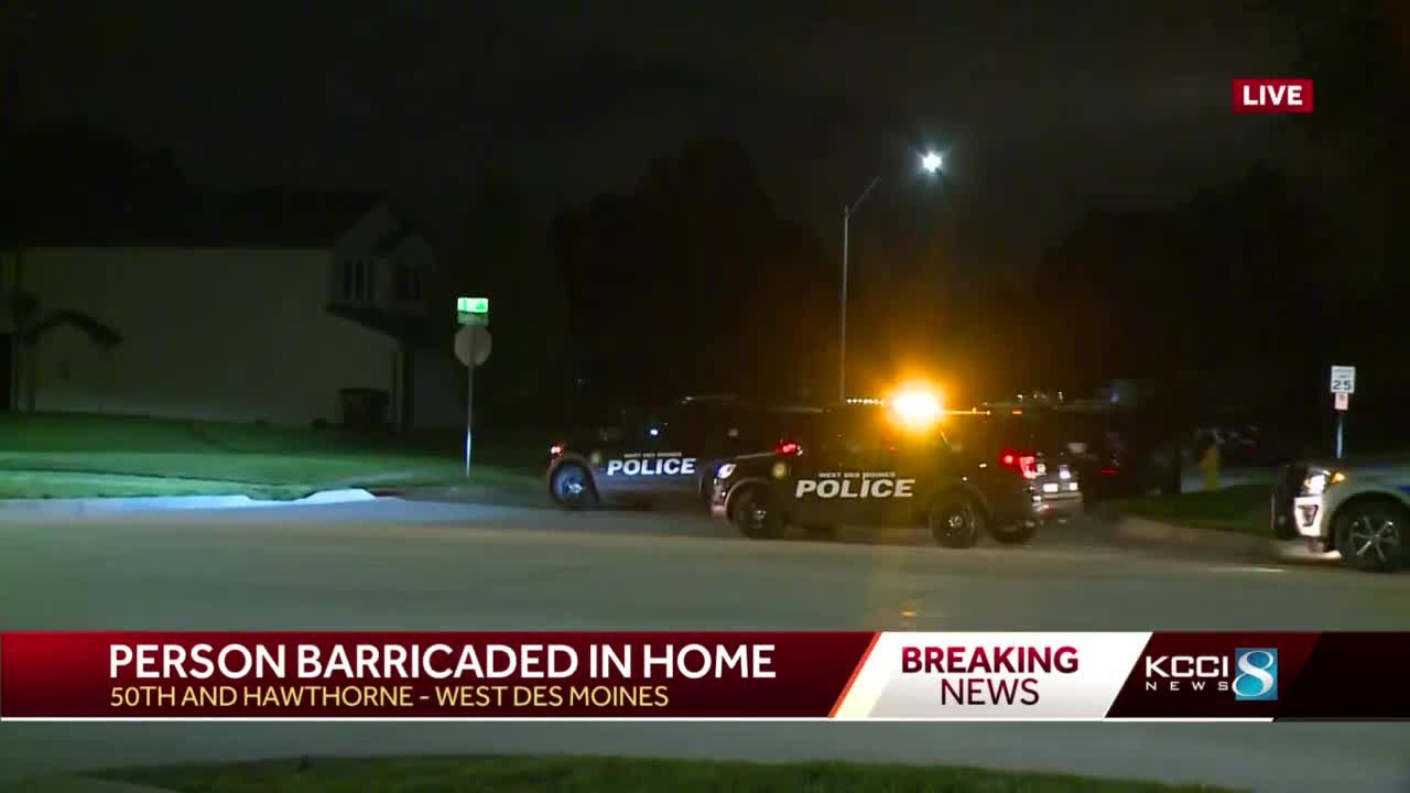 Developing: Police say man barricaded in home with weapon