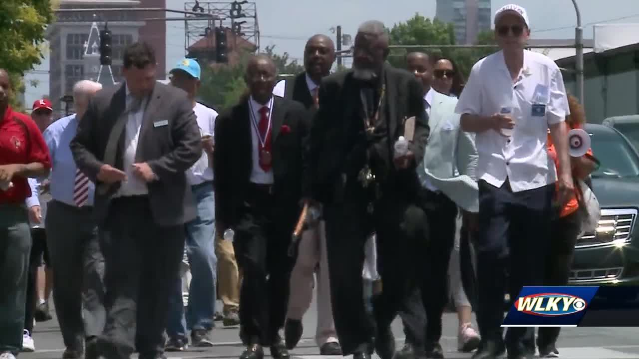 Community members gather for peace walk to demand an end to deadly violence citywide
