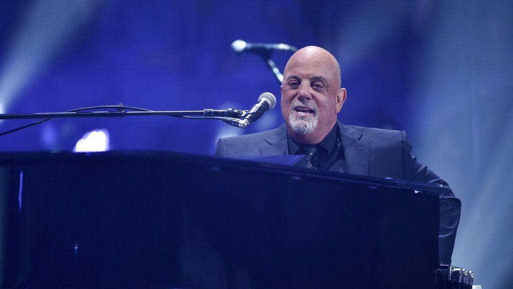 Billy Joel playing in the rain in Fenway Park