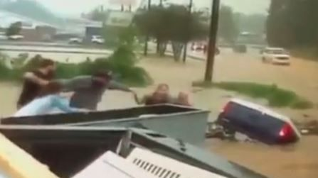 Tattoo shop employees save man from flood waters in Winston-Salem