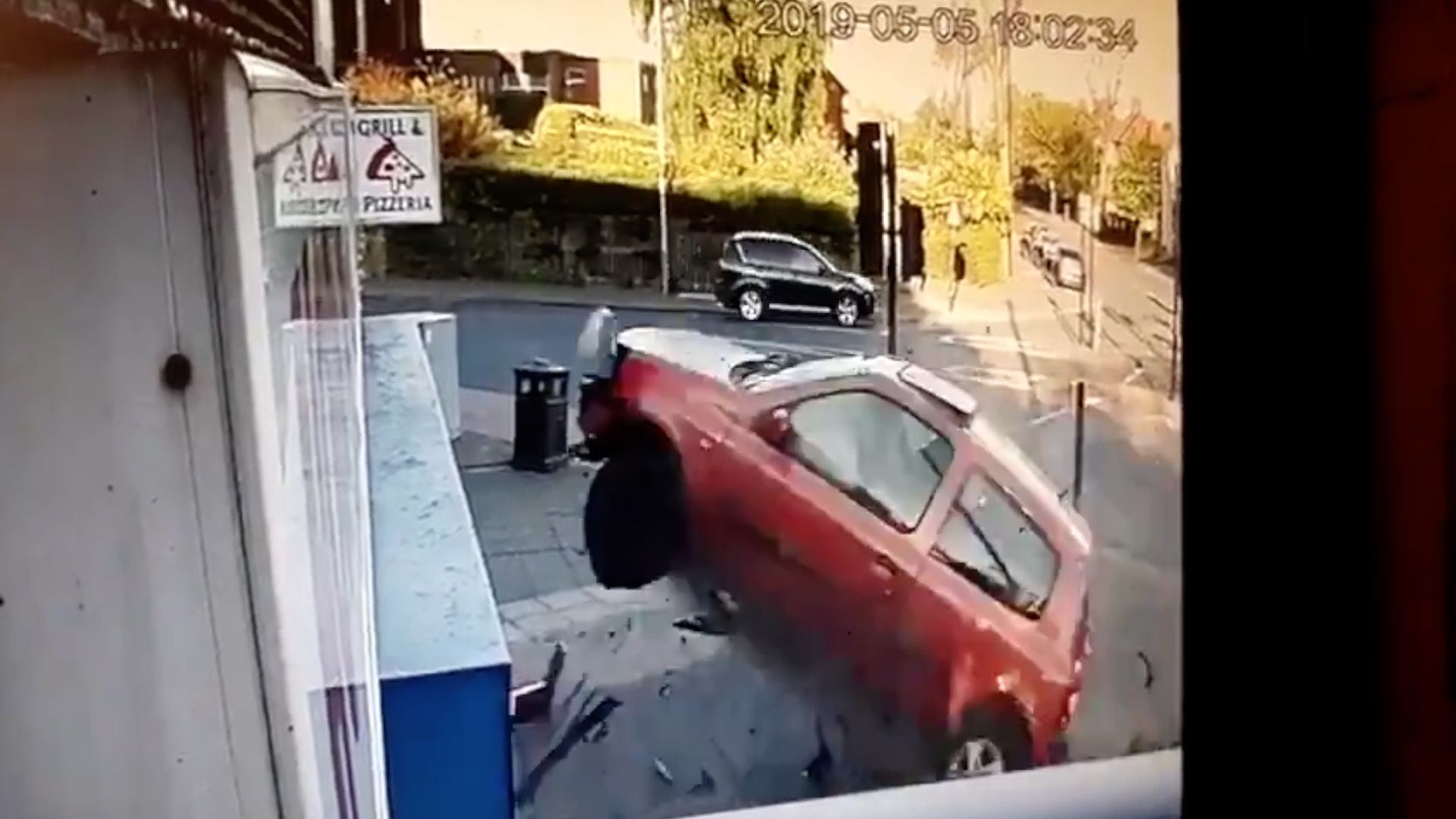 Watch: Car Goes Airborne, Crashes Into Pizza Restaurant