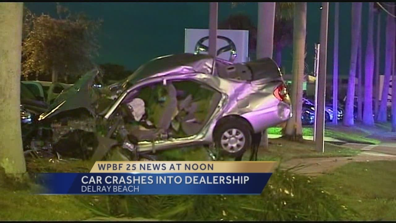 Car crashes into Delray Beach dealership