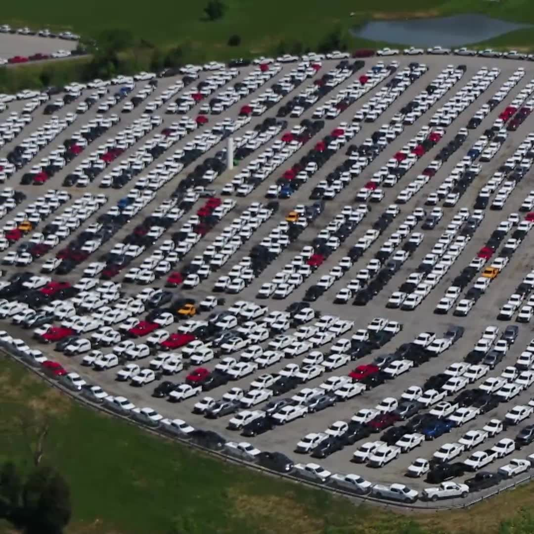Thousands and thousands of trucks sit, useless, in Northern Kentucky